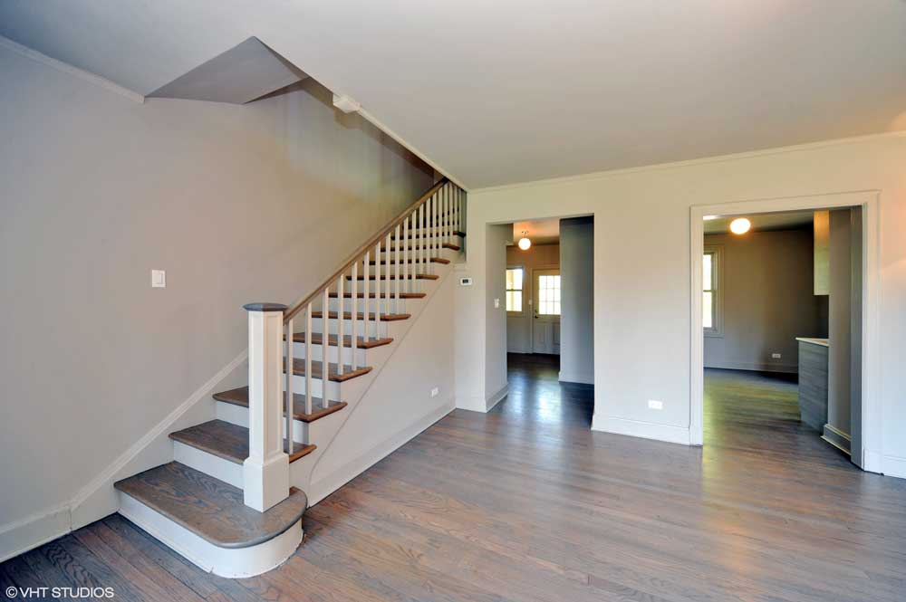 Westover Townhomes stairwell and hallway with natural wood foor