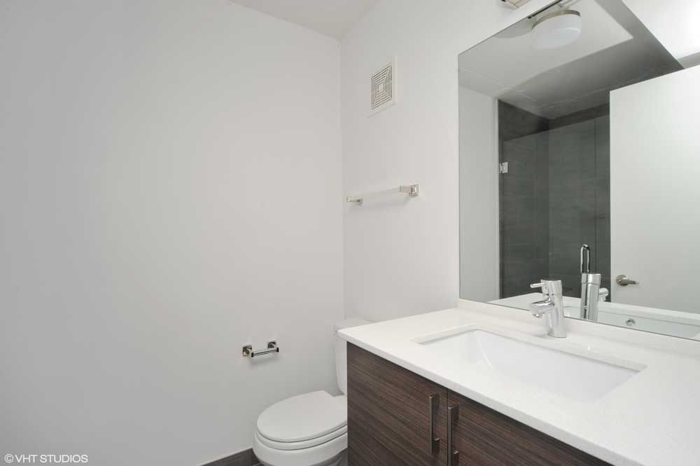 Westover Townhomes Bathroom with custom cabinetry, Grohe plubing fixtures, TOTO toilets, and more!