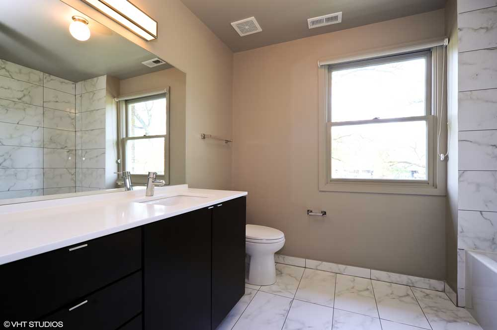 Westover Townhomes bathroom with designer tile from floor to ceiling