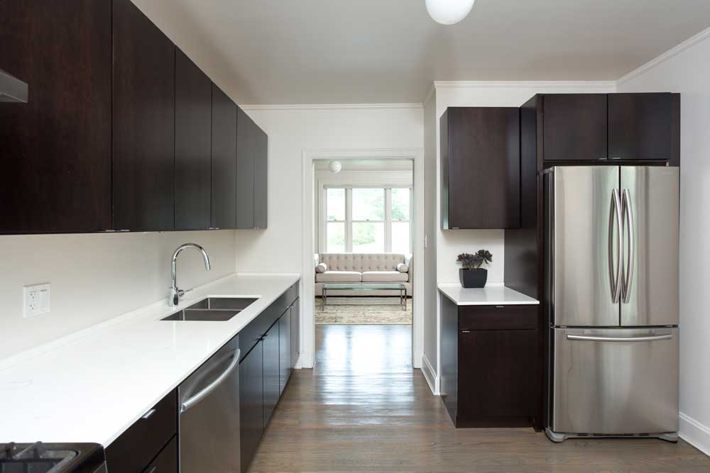 Westover Townhomes beautiful kitchen outfitted with bustom cabinetry, quartz countertops, and sleek Samsung stainless steel appliances