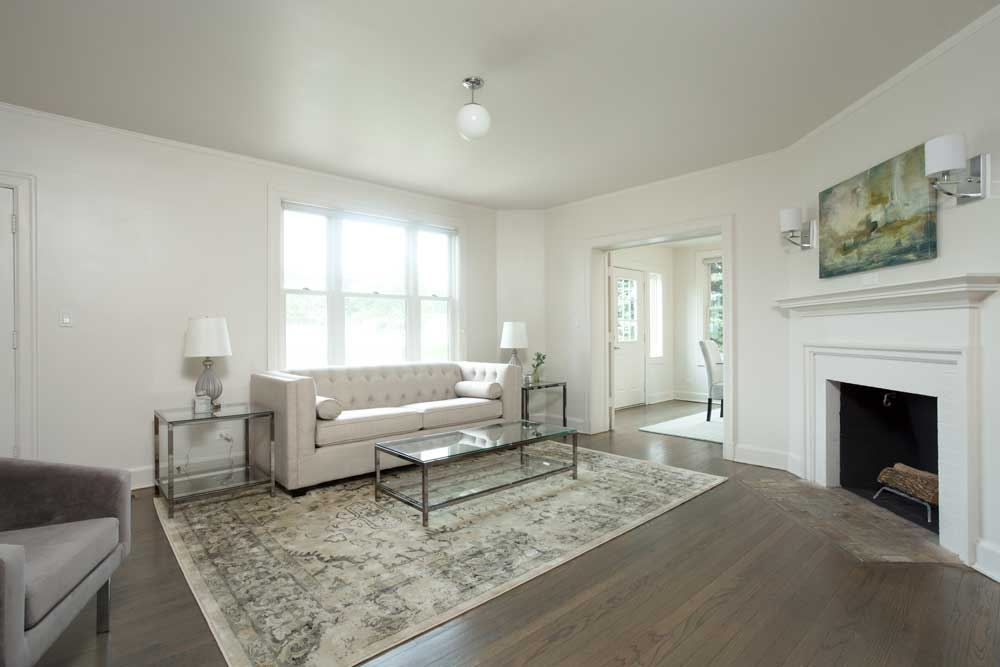 Westover Townhomes spacious living room with fireplace and natural hardwood floor