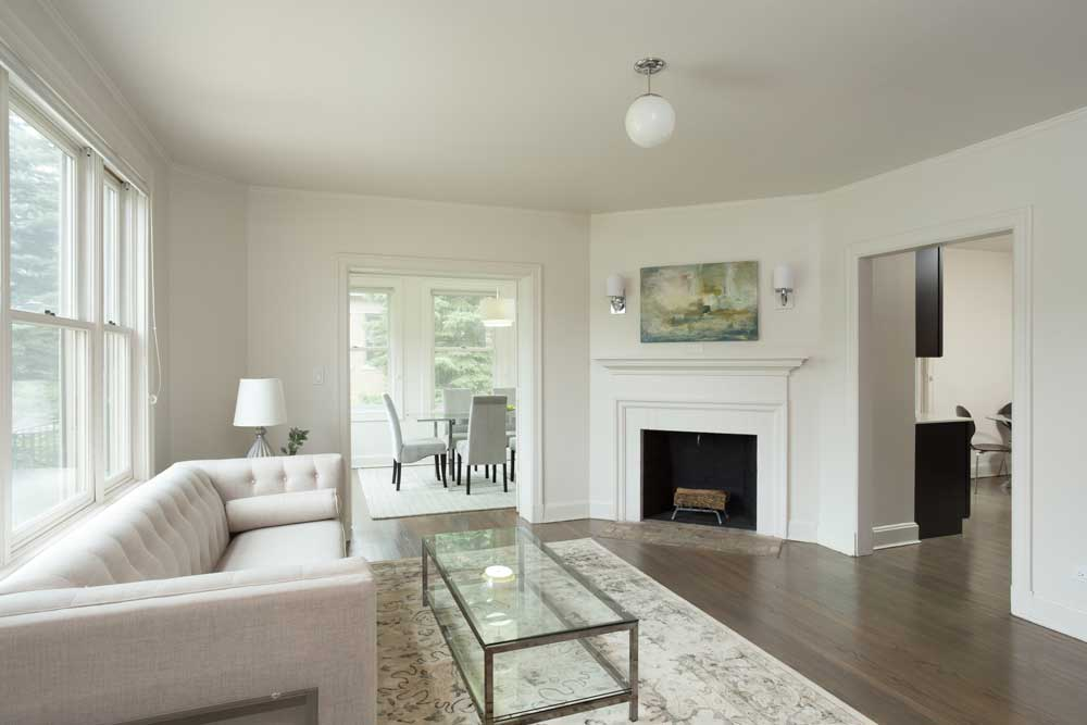 Westover Townhomes living room with fireplace and natural hardwood floor