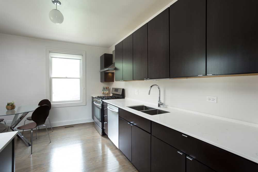 Westover Townhomes beautiful kitchen outfitted with custom cabinetry, quartz countertops, and sleek Samsung stainless steel appliances