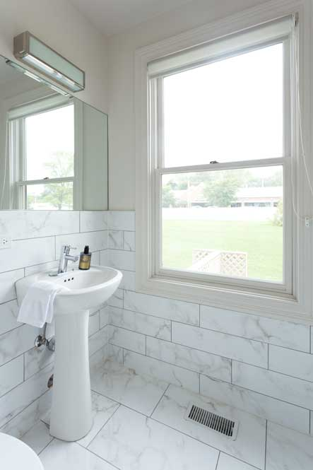 Westover Townhomes bathrooms and powder room include designer til and high-end Grohe plumbing fixtures