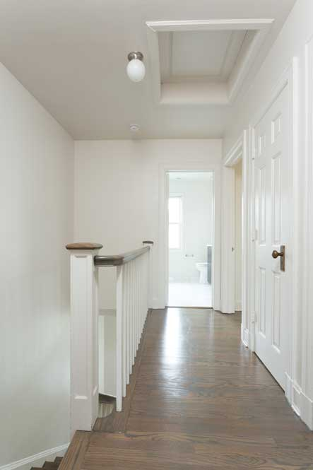 Westover Townhomes stariwell and hallway with natural hardwood floor