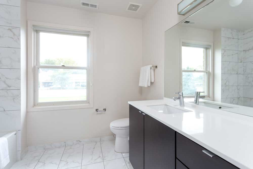 Westover Townhomes bathroom with designer tile, high-end Grohe plumbing fixtures and TOTO toilets